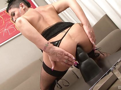 Horny Caro La Petite Bombe gets her butt drilled with a black cock