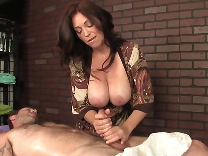 Hot masseuse with huge boobs helps the client relax by a handjob