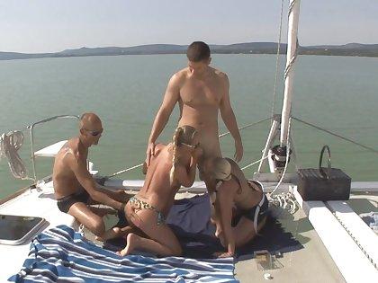 Swingers swap pleasure in intimate boat urgency XXX