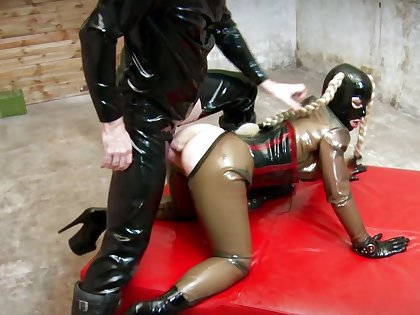 Bitch in latex costume, full fetish anal display in doggy